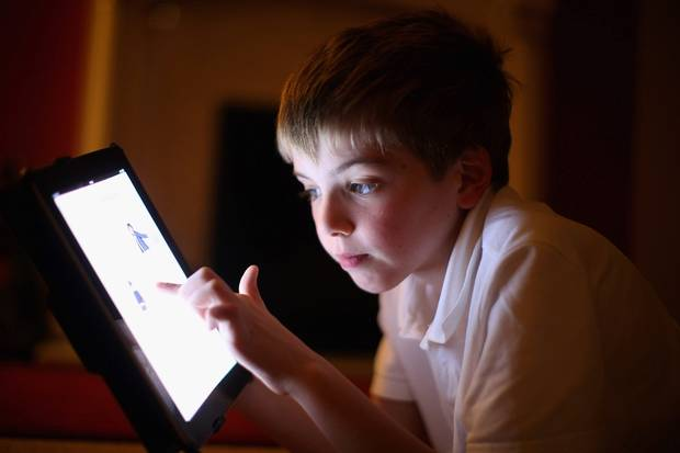 Child on Tablet.